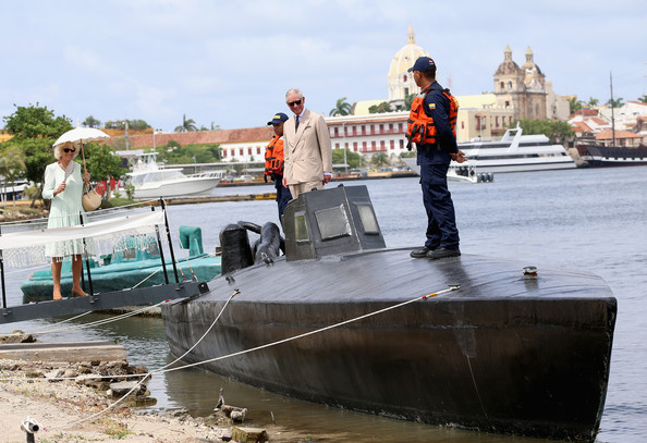 Camilla, Duchess of Cornwall and Prince Charles, Prince of Wales are shown a 'homemade' fibreglass semi-submersive vessel used to smuggle up to 2 tonnes of Cocaine as they visit the CoastGuard on October 31, 2014 in Cartagena, Colombia. The Royal Couple are on a four day visit to Colombia as part of a Royal tour to Colombia and Mexico. After fifty years of armed conflict in Colombia the theme for the visit is Peace and Reconciliation.