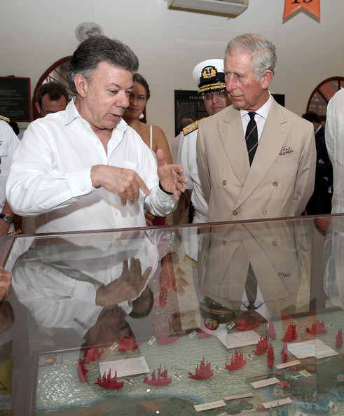 President of Colombia Juan Manuel Santos and Prince Charles, Prince of Wales visit the Cartagena Museum on October 31, 2014 in Cartagena, Colombia. The Royal Couple are on a four day visit to Colombia as part of a Royal tour to Colombia and Mexico. After fifty years of armed conflict in Colombia the theme for the visit is Peace and Reconciliation.
