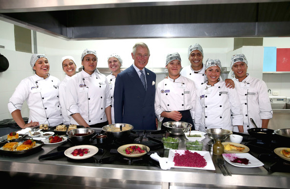 Prince Charles, Prince of Wales meets chefs during a visit to a 'Skill School' on October 29, 2014 in Bogota, Colombia. The Royal Couple are on a four day visit to Colombia as part of a Royal tour to Colombia and Mexico. After fifty years of armed conflict in Colombia the theme for the visit is Peace and Reconciliation.
