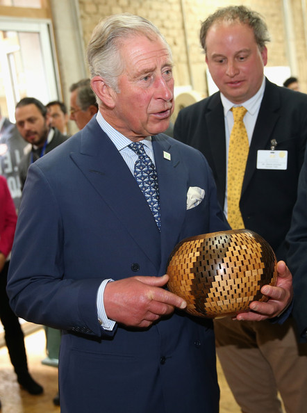 Prince Charles, Prince of Wales is presented with a handmade gift during a visit to a woodwork workshop at a 'Skill School' on October 29, 2014 in Bogota, Colombia. The Royal Couple are on a four day visit to Colombia as part of a Royal tour to Colombia and Mexico. After fifty years of armed conflict in Colombia the theme for the visit is Peace and Reconciliation.