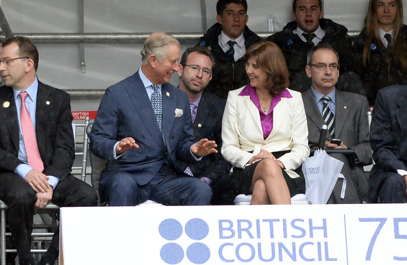 Prince Charles, Prince of Wales, Vice Royal Patron, and Foreign Minister Maria Angela Holguin view a rugby demonstration during a celebration marking the 75th Anniversary of the British Council in Colombia at Gimnasio Moderno School, on October 29, 2014 in Bogota, Colombia. The Royal Couple are on a four day visit to Colombia as part of a Royal tour to Colombia and Mexico. After fifty years of armed conflict in Colombia the theme for the visit is Peace and Reconciliation.