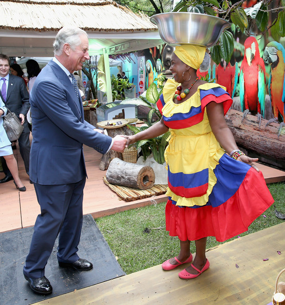 Prince Charles, Prince of Wales meets Carribbean Themed guests at a Sustainability Fair at the Ambassador'd Residence on October 29, 2014 in Bogota, Colombia. The Royal Couple are on a four day visit to Colombia as part of a Royal tour to Colombia and Mexico. After fifty years of armed conflict in Colombia the theme for the visit is Peace and Reconciliation.