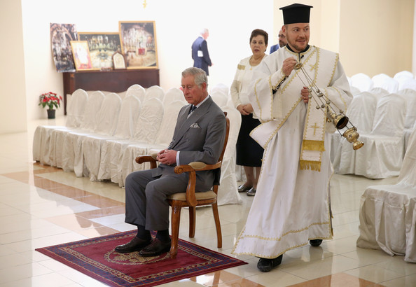 Prince Charles, Prince of Wales sits down during his visit St Issac and St George Greek Orthodox Church on February 21, 2014 in Doha, Qatar. The Prince is on a three day solo visit to Qatar following a short visit to Saudi Arabia.