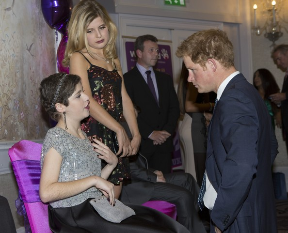Prince Harry Prince Harry meets Cecilia (Cissy) Adamou (15) , Inspirational young person award winner 12-13, during the WellChild awards at the London Hilton on September 22, 2014 in London, England.