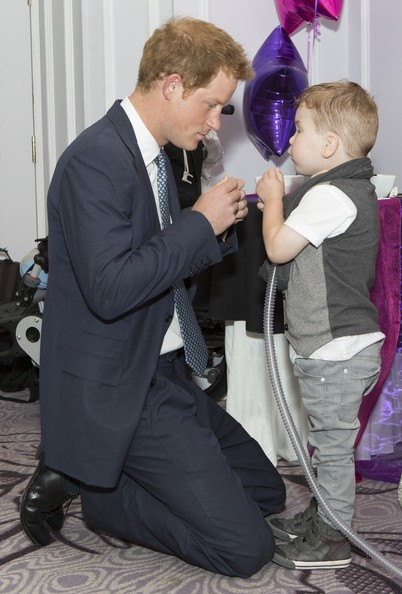 Prince Harry Prince Harry meets Carson Hartley (4) who suffers from lung disease, heart defect, Spina bifida and brittle bone disease, during the WellChild awards at the London Hilton on September 22, 2014 in London, England.