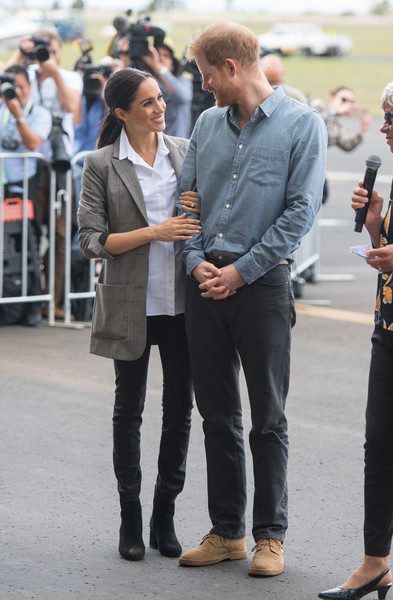 The Duke And Duchess Of Sussex Visit Australia - Day 2 [jeans,infrastructure,standing,denim,car,suit,road,street,outerwear,fashion,harry,aircraft,naming,australia,sussex,duchess,dubbo airport,duke of sussex,duke and duchess of sussex visit,unveiling ceremony]