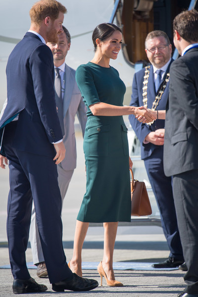 The Duke And Duchess Of Sussex Visit Ireland [suit,formal wear,dress,standing,fashion,outerwear,white collar worker,event,tuxedo,flooring,harry,meghan,ireland,duke and duchess of sussex,airport,sussex,duchess,duke of sussex,visit,visit]