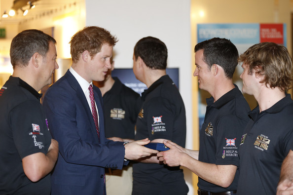 Britain's Prince Harry, 2nd left, hands medals to members of the Row2Recovery crew at the River and Rowing Museum on March 10, 2014 in Henley on Thames, England. Prince Harry will met the Row to Recovery crew of wounded ex-servicemen who successfully rowed across the Atlantic in 2013. The Endeavour Fund, created by The Royal Foundation of The Duke and Duchess of Cambridge and Prince Harry, has supported Row to Recoverys legacy project to improve access to rowing facilities to aid recovery of wounded ex-servicemen and women.