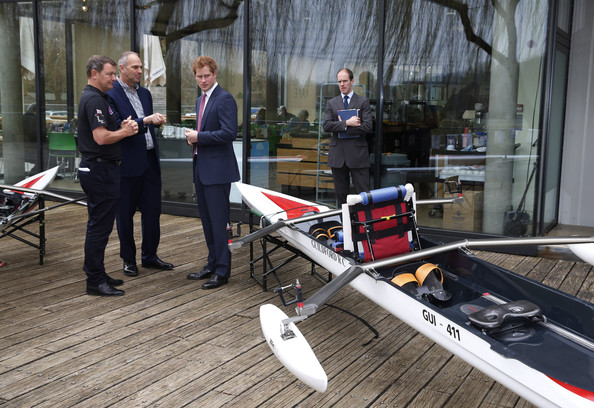Britain's Prince Harry, centre right, and British former rowing great Steven Redgrave, centre left, listen to a member of Row2Recovery, left, at the River and Rowing Museum on March 10, 2014 in Henley on Thames, England. Prince Harry will met the Row to Recovery crew of wounded ex-servicemen who successfully rowed across the Atlantic in 2013. The Endeavour Fund, created by The Royal Foundation of The Duke and Duchess of Cambridge and Prince Harry, has supported Row to Recoverys legacy project to improve access to rowing facilities to aid recovery of wounded ex-servicemen and women.