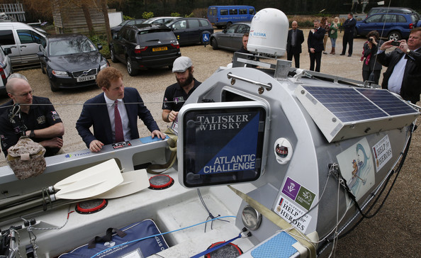 Britain's Prince Harry inspects the Row2Recovery crew's rowing boat, which they used to successfully row across the Atlantic in 2013, outside the River and Rowing Museum on March 10, 2014 in Henley on Thames, England. Prince Harry will met the Row to Recovery crew of wounded ex-servicemen who successfully rowed across the Atlantic in 2013. The Endeavour Fund, created by The Royal Foundation of The Duke and Duchess of Cambridge and Prince Harry, has supported Row to Recoverys legacy project to improve access to rowing facilities to aid recovery of wounded ex-servicemen and women.