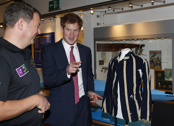 Britain's Prince Harry, centre, talks as he passes the exhibits at the River and Rowing Museum on March 10, 2014 in Henley on Thames, England. Prince Harry will met the Row to Recovery crew of wounded ex-servicemen who successfully rowed across the Atlantic in 2013. The Endeavour Fund, created by The Royal Foundation of The Duke and Duchess of Cambridge and Prince Harry, has supported Row to Recoverys legacy project to improve access to rowing facilities to aid recovery of wounded ex-servicemen and women.