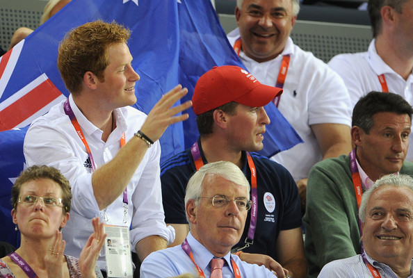 Prince Harry Prince Harry waves to his cousin Princess Beatrice as he sits with Peter Phillips, LOCOG Chair Lord Sebastian Coe and former Prime Minister John Major (front) at the Track Cycling on Day 11 of the London 2012 Olympic Games at the Velodrome on August 7, 2012 in London, England.