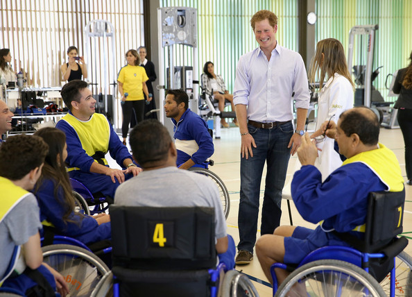Prince Harry chats to patients taking part in a wheelchair basketball rehabilitation class at the Rede Sarah Hospital for Nerological Rehabilitation injuries on June 23, 2014 in Brasilia, Brazil. Prince Harry is on a four day tour in Brazil that will be followed by two days in Chile.