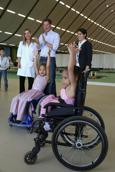 Prince Harry meets patients at the Rede Sarah Hospital for Nerological Rehabilitation injuries as he takes part in a canoe therapy session on Lake Paranoa on June 23, 2014 in Brasilia, Brazil.  Prince Harry is on a four day tour of Brazil that will be followed by Two days in Chile.