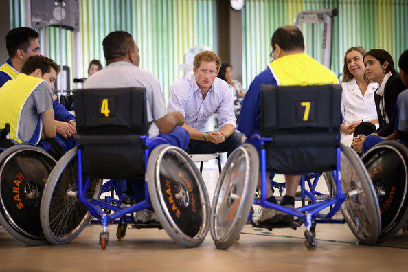 Prince Harry chats to patients in the Rede Sarah Hospital for Nerological Rehabilitation injuries as he takes part in wheelchair basketball therapy session on June 23, 2014 in Brasilia, Brazil.  Prince Harry is on a four day tour of Brazil that will be followed by Two days in Chile.