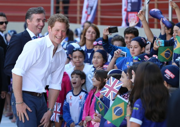 Prince Harry and British Ambassador Alex Ellis meet young swimmers during a visit to Minas Tenis Clube on the second day of his tour of Brazil on June 24, 2014 in Belo Horizonte, Brazil. Prince Harry is on a four day tour of Brazil that will be followed by two days in Chile.