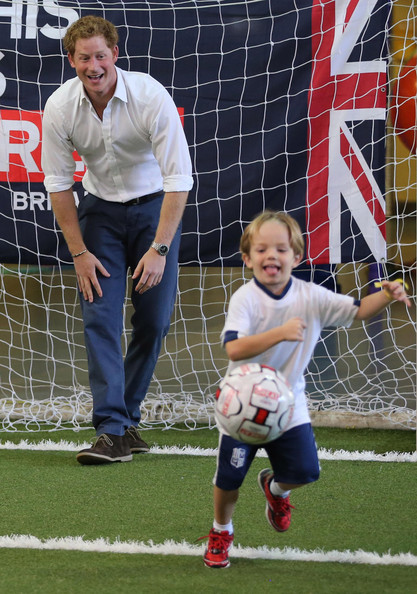 Prince Harry plays football with young school children during a visit to Minas Tenis Clube on the second day of his tour of Brazil on June 24, 2014 in Belo Horizonte, Brazil. Prince Harry is on a four day tour of Brazil that will be followed by two days in Chile.