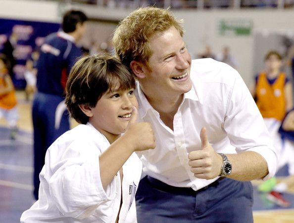 Prince Harry poses for a photo with a young judo player during a visit to Minas Tenis Clube supporting the UK's GREAT Campaign on June 24, 2014 in Belo Horizonte, Brazil.  Prince Harry is on a four day tour of Brazil that will be followed by Two days in Chile.