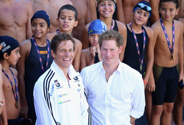 Prince Harry  poses with Brazilian Olympic swimmer Cesar Cielo during a visit to Minas Tenis Clube supporting the UK's GREAT Campaign on June 24, 2014 in Belo Horizonte, Brazil.  Prince Harry is on a four day tour of Brazil that will be followed by Two days in Chile.