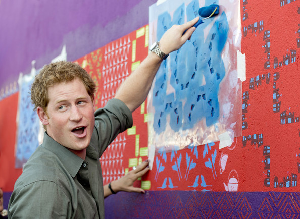 Prince Harry has a go at some local artwork during a trip to the Atlantic Rainforest on June 25, 2014 near Sao Paulo, Brazil. Prince Harry is on a four day tour of Brazil that will be followed by two days in Chile.