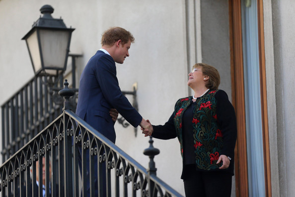 Prince Harry shakes hands with Chilean President Michelle Bachelet as he visits the La Moneda Presidential Palace on June 27, 2014 in Santiago, Chile.  Prince Harry is on a three day tour of Chile after visiting Brazil.