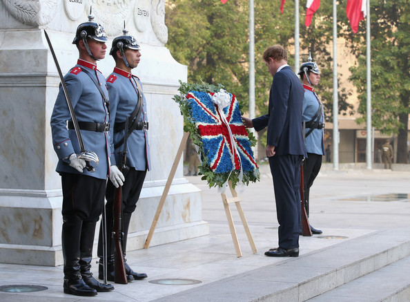 Prince Harry lays a wreath at the monument to the founding Father of Chile Bernando O'Higgins on June 27, 2014 in Santiago, Chile.  Prince Harry is on a three day tour of Chile after visiting Brazil.