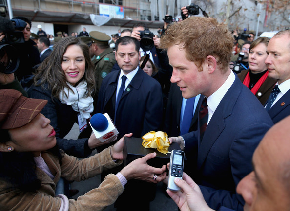 Prince Harry talks to the Chilean media and members of the public after laying a wreath at the monument to the founding Father of Chile Bernando O'Higgins on June 27, 2014 in Santiago, Chile.  Prince Harry is on a three day tour of Chile after visiting Brazil.
