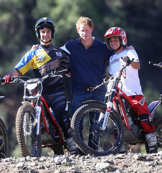 Prince Harry poses with trails bike riders during a visit to an outdoor centre on June 29, 2014 in Antaeaya, Chile. Prince Harry is on the final day of a three day tour of Chile after visiting Brazil.