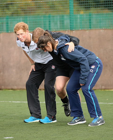 Prince Harry, Patron of England Rugby's All Schools Programme, takes part in a rugby training session with England women's rugby player Sarah Hunter (R) at Eccles RFC on October 20, 2014 in Manchester, England.