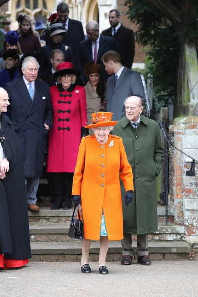 Members of the Royal Family Attend St Mary Magdalene Church in Sandringham [standing,suit,fashion,outerwear,academic dress,tradition,coat,uniform,formal wear,girl,members,charles,elizabeth ii,philip,harry,duke,service,the royal family attend st mary magdalene church,sandringham,prince of wales]