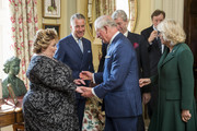 Prince Charles, Prince of Wales and Camilla, Duchess of Cornwall are greeted by New Lord Lieutenant of Belfast Fionnuala Jay-O'Boyle (L) during a reception at Hillsborough Castle on April 9, 2019 in Belfast, Northern Ireland.