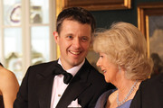 Crown Prince Frederik of Denmark (L) chats to Camilla, Duchess of Cornwall in a receiving line ahead of an official dinner at the Royal Palace on March 26, 2012 in Copenhagen, Denmark. Prince Charles, Prince of Wales and Camilla, Duchess of Cornwall are on a Diamond Jubilee tour of Scandinavia that takes in Norway, Sweden and Denmark.