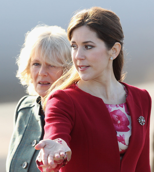 Princess Mary of Denmark gestures to Camilla, Duchess of Cornwall talk at Copenhagen Kastrup Airport on March 24, 2012 in Copenhagen, Denmark. Prince Charles, Prince of Wales and Camilla, Duchess of Cornwall are on a Diamond Jubilee tour of Scandinavia that takes in Norway, Sweden and Denmark.
