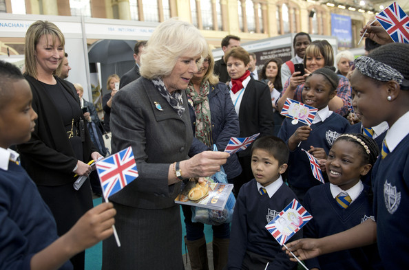 Camilla, Duchess of Cornwall looks at pictures colored in by children from St Monica's RC Primary school in Hoxton Square during The Edible Garden Show at Alexandra Palace on March 28, 2014 in London, England.