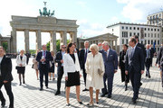 Prince Charles, Prince of Wales, and Camilla, Duchess of Cornwall, walk to the Adlon Hotel accompanied by Berlin Mayor Michael Mueller (R) and his wife Claudia (C) after greeting members of the public at the Brandenburg Gate on May 07, 2019 in Berlin, Germany. Their Royal Highnesses are on a 4-day-trip from May 7-10 that will include visits to Berlin, Leipzig and Munich.