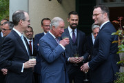 Prince Charles, Prince of Wales, chats with German Health Minister Jens Spahn (R) and other guests at the Queen's Birthday reception at the British ambassador's residence on May 07, 2019 in Berlin, Germany. Their Royal Highnesses are on a 4-day-trip from May 7-10 that will include visits to Berlin, Leipzig and Munich.