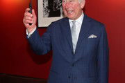 Prince Charles, Prince of Wales cuts a cake to commemorate the BFI's 40 years of Royal patronage during an official visit to BFI Southbank on December 06, 2018 in London, England.  The Prince of Wales has been Patron of the British Film Institute for 40 years.