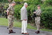 Prince Charles, Prince of Wales greets a soldier as he is received by Commanding Officer, Lieutenant Colonel Henry Llewelyn-Usher (L) during a visit to Combermere Barracks on May 5, 2021 in Windsor, England.