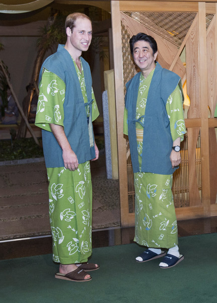 Prince William (L-R) Prince William, Duke of Cambridge and Japanese Prime Minister Shinzo Abe wear 'yukata' as they pose for photographs at a traditional Japanese Ryokan before dinner on February 28, 2015 in Koriyama, Japan. The Duke of Cambridge is visiting Japan from February 26th to March 1st 2015.