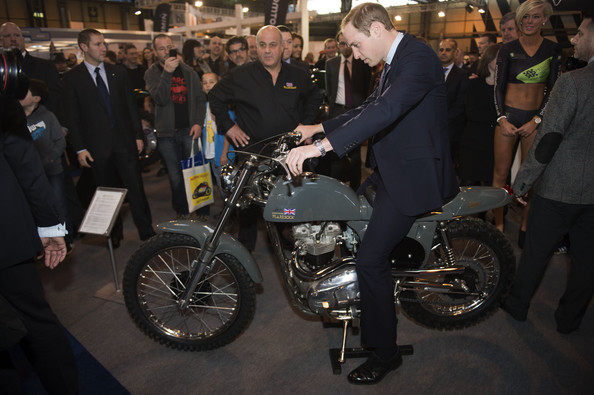 Prince William Prince William, Duke of Cambridge sits on a Metisse Desert Ranger, autographed by Steve McQueen, during a visit to Motorcycle Live at the National Exhibition Centre, where he toured the stands and watched a live motorcycle display on November 30, 2013 in Birmingham, United Kingdom.