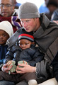 Prince Harry holds a young boy during a visit to a child education centre on June 16, 2010 in Semonkong, Lesotho. The two Princes are on a joint trip to Africa which takes in Botswana, Lesotho and finally South Africa. During that time they will visit a number of projects supported by their respective charities Sentebale (Prince Harry) and Tusk Trust (Prince William). The trip will culminate with the brothers watching the England vs Algeria World Cup match in Cape Town.