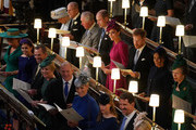 Back (L-R) Queen Elizabeth II, Prince Philip, Duke of Edinburgh, Prince Charles, Prince of Wales, Prince William, Duke of Cambridge, Catherine, Duchess of Cambridge, Prince Harry, Duke of Sussex, Meghan, Duchess of Sussex and Princess Anne, Princess Royal and (front L-R) Sarah Ferguson Princess Beatrice of York, Peter Phillips, Autumn Phillips, Mike Tindall, Zara Tindall  Lady Louise Windsor and Crown Prince Pavlos of Greece attend the wedding of Princess Eugenie of York and Mr. Jack Brooksbank at St. George's Chapel on October 12, 2018 in Windsor, England.