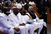 The Rev. Al Sharpton (R) and family members Philonise Floyd (2nd L) and his brother Rodney Floyd (L) attend the funeral service for George Floyd in the chapel at the Fountain of Praise church June 9, 2020 in Houston, Texas. Floyd died May 25 while in Minneapolis police custody, sparking nationwide protests.