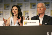 Actors Laura Mennell (L) and Neal McDonough attend the Project Blue Book panel at Comic-Con International on July 21, 2018 in San Diego, California.