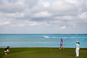 (L-R) Azahara Munoz of Spain, Paula Creamer and Inbee Park of South Korea play the eighth hole during round one of the Pure Silk Bahamas LPGA Classic at the Ocean Club course on February 5, 2015 in Paradise Island, Bahamas.