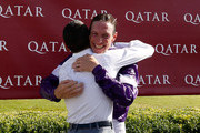 Retiring jockey Richard Hughes hugs Frankie Dettori on day five of the Qatar Goodwood Festival at Goodwood Racecourse on August 1, 2015 in Chichester, England.