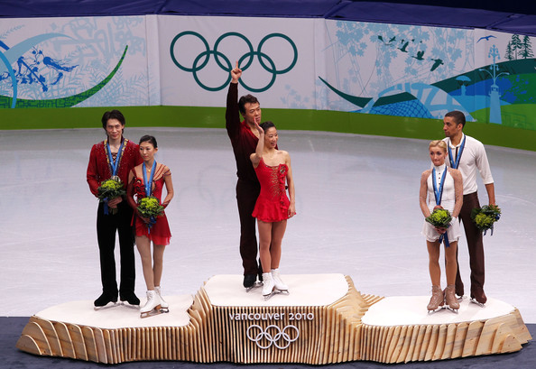 Vancouver 2010 Winter Olympics at the UBC Thunderbird Arena [fashion,event,competition,performance,technology,stage equipment,recreation,podium,performing arts,tourism,figure skating,l-r,silver medal,gold medal,bronze medal,china,jian tong,qing pang,robin szolkowy,aliona savchenko]