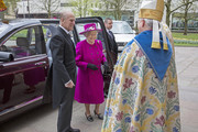 Queen Elizabeth II and Prince Philip, Duke of Edinburgh are greeted by the Very Reverend Christopher Armstrong, Dean of Blackburn, and The Right Reverend Julian Henderson, Bishop of Blackburn, as they arrive at Blackburn Cathedral for a Royal Maundy Service  on April 17, 2014 in Blackburn, England.
