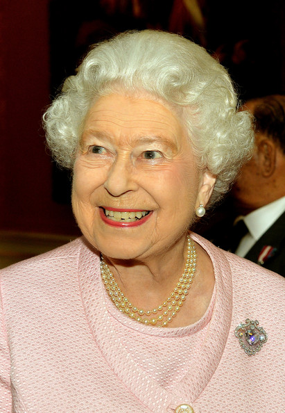 Queen Elizabeth II smiles as she talks to an ex-Soldier at a reunion reception for the Victoria and George Cross Association, in the picture Gallery of Buckingham Palace on October 28, 2014 in central London.