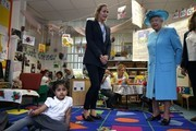Britain's Queen Elizabeth II (R) is shown around a classroom at Mayflower Primary School during a visit to Poplar in Tower Hamlets in East London on June 15, 2017, as part of commemorations to mark the centenary of the bombing of Upper North Street School during the First World War..Mayflower Primary School now exists on the site of the Upper North Street School. / AFP PHOTO / POOL / Daniel LEAL-OLIVAS